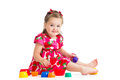 Baby girl playing with cup toys over white Royalty Free Stock Image