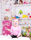 Baby girl playing with soap bubbles happy smiling Royalty Free Stock Photos