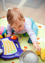 Baby girl playing with toys Stock Image
