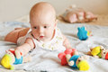 Baby girl playing with toys Royalty Free Stock Image