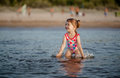 Baby girl playing with a water in the sea adorable Royalty Free Stock Photos
