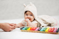 Baby girl playing with xylophone toy at home Royalty Free Stock Photo