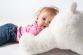 Baby girl plays with white bear toy Royalty Free Stock Photo