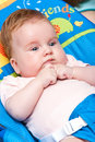 Baby girl in rocker Stock Images