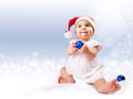 Baby girl in santa's hat Royalty Free Stock Photos