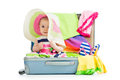 Baby girl sitting in suitcase Royalty Free Stock Photo