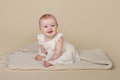 Baby girl sitting up beautiful on blanket looking at the camera Royalty Free Stock Photo