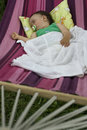 Baby girl sleeping in hammock Stock Photo