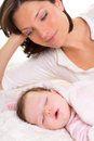 Baby girl sleeping with mother care near Stock Photo