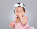 Baby girl sneeze Royalty Free Stock Photo