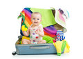Baby girl in suitcase with things for vacation sitting travel Stock Photos