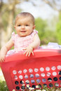 Baby Girl In Summer Dress Sitting Stock Photo