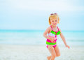 Baby girl in sunglasses playing on beach Royalty Free Stock Photo