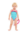 Baby girl in swimsuit holding handbag Royalty Free Stock Photos