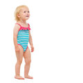 Baby girl in swimsuit looking on copy space Royalty Free Stock Photography