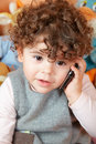 Baby girl talking on phone Stock Photo