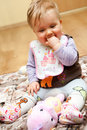 Baby girl with toys Stock Photography