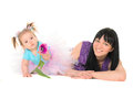 Baby girl in tutu holding hands tulip for mom isolated white background Stock Photos
