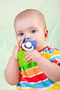 Baby girl with two pacifiers. Stock Photography