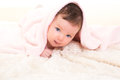Baby girl under hidden pink blanket on white fur Royalty Free Stock Photo