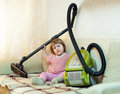 Baby girl with vacuum cleaner Stock Photo