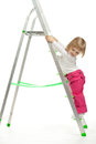 A baby girl walking down the stepladder Royalty Free Stock Photography