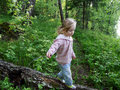 Baby girl walking in forest Stock Image