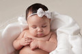Baby Girl with White Bow Headband Royalty Free Stock Photo