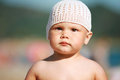 Baby girl in white hat on the beach outdoor summer portrait of caucasian Stock Images