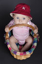 Baby girl in a wicker basket sitting Royalty Free Stock Photography