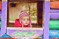Baby girl in wooden house on the playground Royalty Free Stock Photos
