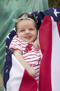 Baby  girl wrapped in American flag Royalty Free Stock Photo