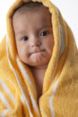 Baby Girl Wrapped In A Towel With An Odd Expressi Stock Photography