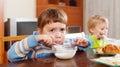 Baby girls eating dairy breakfast