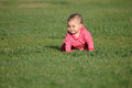 Baby on the grass cute a green Royalty Free Stock Images