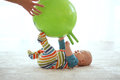 Baby gymnastic playing with ball with mother at home Royalty Free Stock Photos