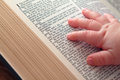 Baby Hand on Open Bible Royalty Free Stock Photo