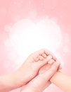 Baby hand in mother hand softly with pink glitter background Stock Photography