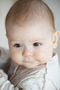 Baby on hands looking sideways closeup photo Royalty Free Stock Photo