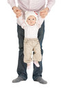 Baby hanging on fathers hands picture of Royalty Free Stock Images