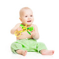 Baby happy smiling smal kid boy in green bow tie sitting over white background Royalty Free Stock Photo