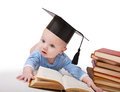 Baby in a hat of the bachelor and the book concept early education Stock Image