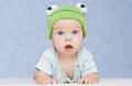 Baby in the hat frog Royalty Free Stock Photo