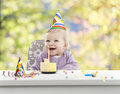 Baby having her first birthday blurred background green and yellow Royalty Free Stock Images
