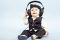 Baby with headphone the beautiful boy Royalty Free Stock Image