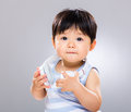 Baby with headphone gray background Royalty Free Stock Photography