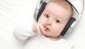 Baby with headphone lies on back Royalty Free Stock Photo