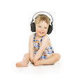 Baby in Headphones Listening to Music, Small Child isolated over Royalty Free Stock Photo