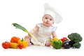 Baby with healthy food vegetables chef Stock Photo
