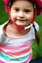 Baby with helmet a closeup of a sweet little toddler girl pigtails wearing a pink shallow depth of field Stock Images